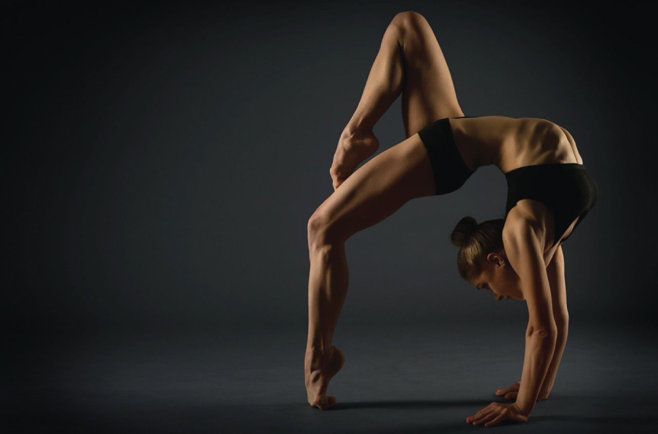 Gymnast performing a back bend experiencing no pain