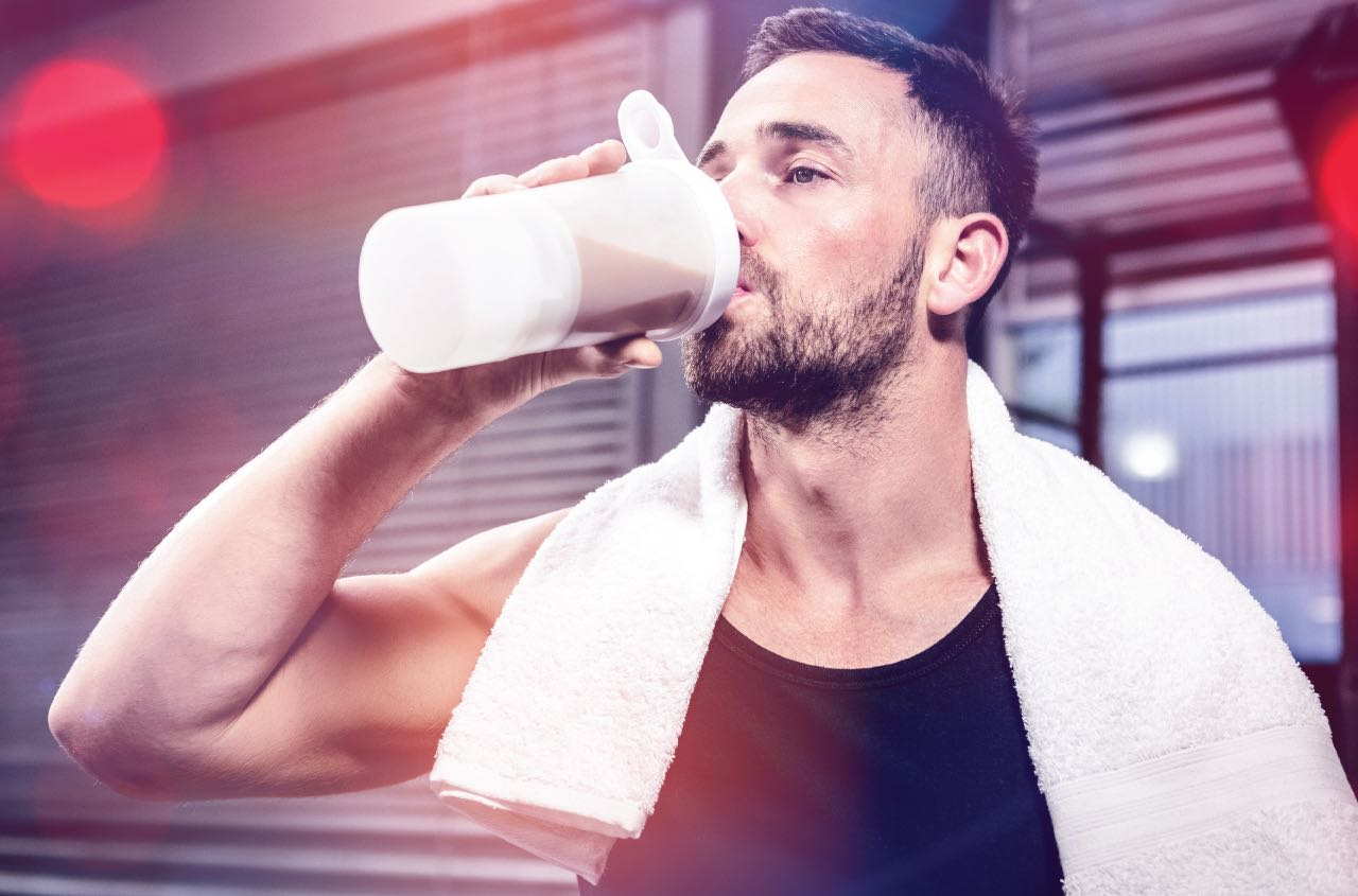 Drinking protein shake after workout